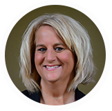 CadmiumCD gets lots of positive feedback from clients of the Survey Magnet. Robin Feldman is one of those clients. In this picture she has short grey hair, fun earrings that dangle by her neck, and a smile that makes you feel warm and welcomed.